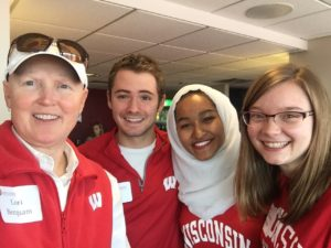 Dean of Students Lori Berquam meets with Wisconsin Union Council at fall football game.