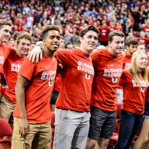 "First-year students link arms and sing ""Varsity"" at the end of the Chancellor's Convocation for New Students, a Wisconsin Welcome event held at the Kohl Center at the University of Wisconsin-Madison on Sept. 4, 2018. (Photo by Jeff Miller / UW-Madison)"