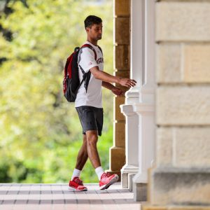 A pedestrian walks through the arched portico of Bascom Hall at the University of Wisconsin-Madison to enter the building during the first day of Fall-semester classes on Sept. 6, 2016. (Photo by Jeff Miller/UW-Madison)