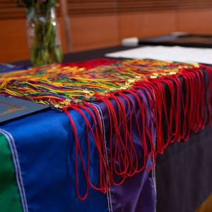 Rainbow colored tassels appear on a table at Rainbow Graduation, an annual event hosted by the Gender and Sexuality Campus Center.