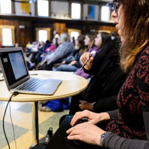 Interpreter Nicole Bresnick provides caption-to-screen Communications Access Realtime Translation (CART) service as deaf activist, actor and model Nyle DiMarco converses with an invited audience of nearly 200 high school and college students -- many deaf, blind and/or hard of hearing -- during a question and answer session at Tripp Commons in the Memorial Union at the University of Wisconsin-Madison on Jan. 30, 2018. Sponsored by UW-Madison's Distinguished Lecture Series and the McBurney Disability Resource Center, the community-outreach event occurred a few hours before DiMarco's public lecture that same evening at Shannon Hall. (Photo by Jeff Miller / UW-Madison)
